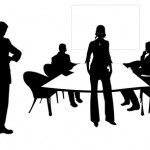 Silhouettes of people sitting around a table in a meeting